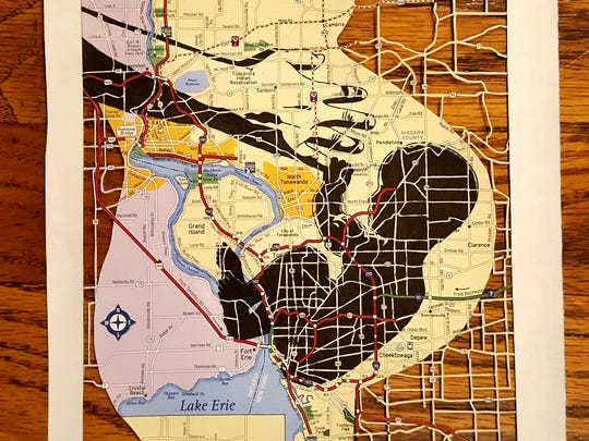 Pen and ink on a map of Buffalo, NY, with sections cut out with a razor.