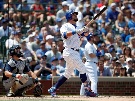Chicago Cubs' Kyle Schwarber, right, watches his solo home run as San Diego Padres catcher Austin Hedges, left, looks on during the second inning of a baseball game in Chicago, on Saturday, Aug. 4, 2018. (AP Photo/Jeff Haynes)