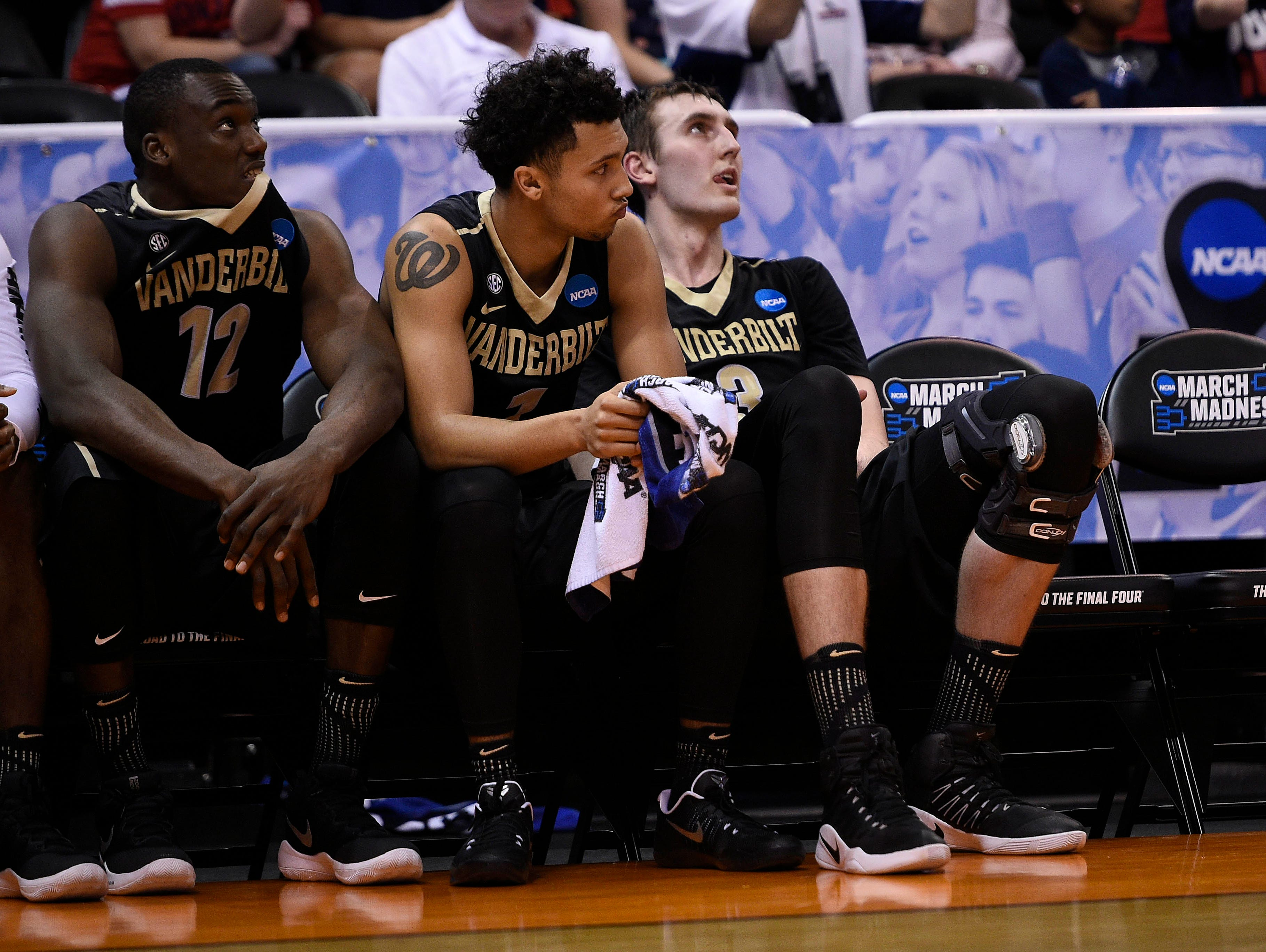 Vanderbilt center Djery Baptiste (12), guard Payton Willis (1) and forward Luke Kornet (3) react during the 68-66 loss against Northwestern in the second half of the first-round NCAA tournament game on March 16, 2017.