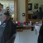 Barbers work on customers at the new Kennedy's Lucky 27 Barbershop & Social Club that opened this week at Jessup Farm artisan village on Timberline Road in Fort Collins.