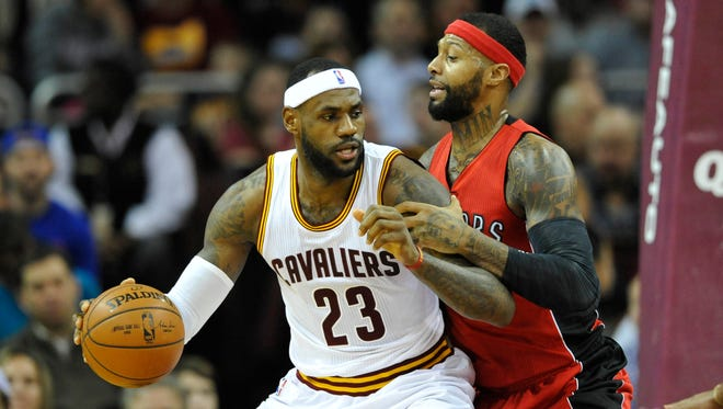 Cleveland Cavaliers forward LeBron James (23) dribbles the ball as Toronto Raptors forward James Johnson (3) defends in the second quarter at Quicken Loans Arena.