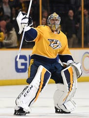 Predators goalie Pekka Rinne (35) waves to the crowd
