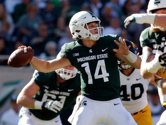 Michigan State quarterback Brian Lewerke throws a pass against Iowa during the first quarter of an NCAA college football game Saturday, Sept. 30, 2017, in East Lansing, Mich. (AP Photo/Al Goldis)