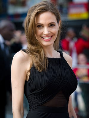 """Actress and activist Angelina Jolie poses as she arrives for the British premiere of """"World War Z"""" in Leicester Square in central London."""