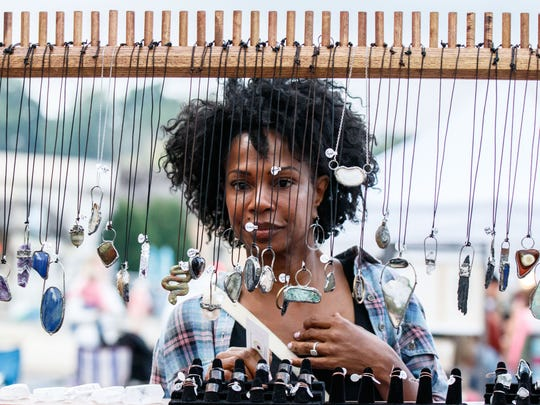 Veleha Moyer of California shops for jewelry during her visit to the annual Fall Art Walk in downtown Delafield on Friday, Sept. 16, 2016.