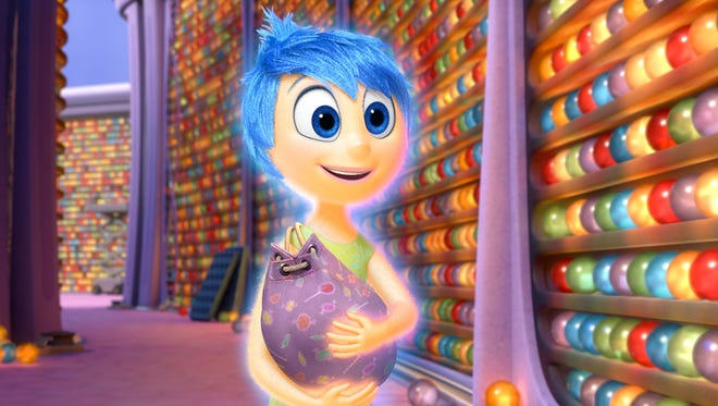 """In this image released by Disney-Pixar, the character Joy, voiced by Amy Poehler, appears in a scene from """"Inside Out,"""" in theaters on June 19."""