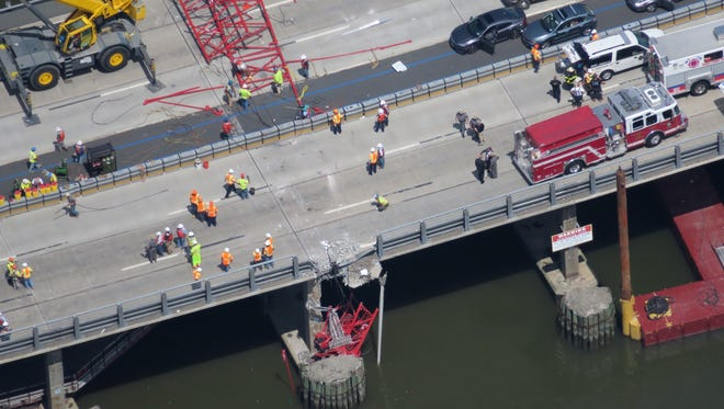 A construction crane collapsed onto the Tappan Zee Bridge on Tuesday, July 19, 2016.