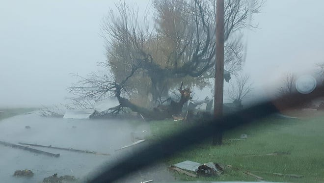 Trees and debris scatter a Hamilton County roadway during severe weather on Sunday, Nov. 5, 2017.
