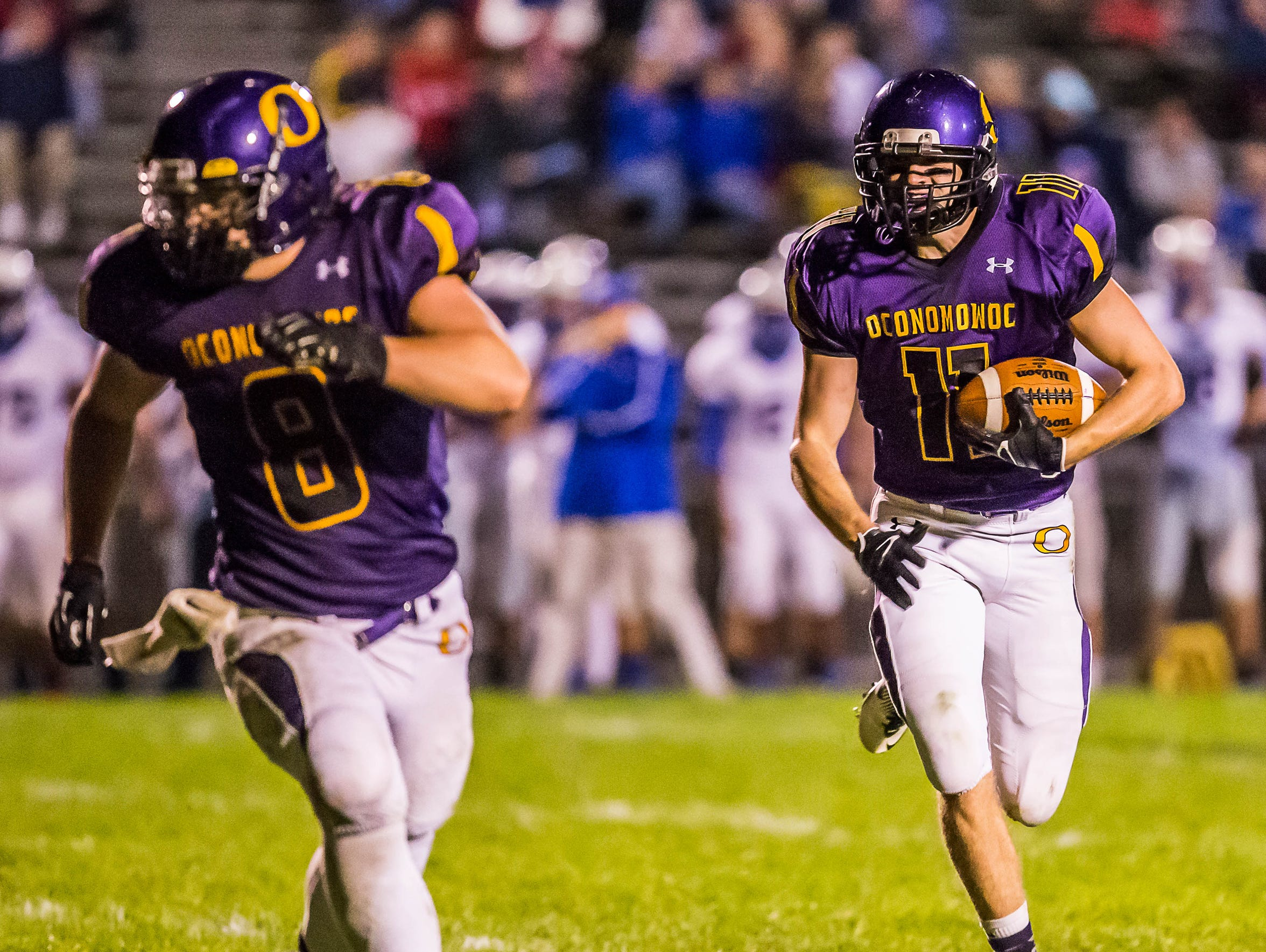 Oconomowoc senior Nate Nord (11) follows teammate Nick