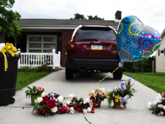 A memorial is of flowers and balloons is set up in the driveway of the home at 805 E. Cypress St. in Palmyra Borough on Tuesday June 7, 2016, where Lorrie Demko was allegedly murdered by her son Jacob Taliaferro, 17, early Monday morning, June 6, 2016, according to a release from the Lebanon County District Attorney's Office. Taliaferro allegedly stabbed Demko and then strangled her until she died, according to the release.