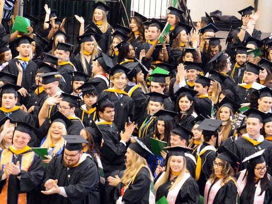 The York College Winter Commencement class turns to thank family members during the ceremony at Grumbacher Sport & Fitness Center Wednesday, Dec. 20, 2017. 300 students graduated. Bill Kalina photo