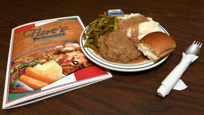 Baked steak with mashed potatoes, gravy, green beans and a roll is the popular Thursday special at Fiore's Restaurant and Bowling in New Lexington.
