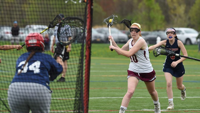 Arlington's Abby Carlin, center, goes for a shot during Wednesday's game against Wappingers.
