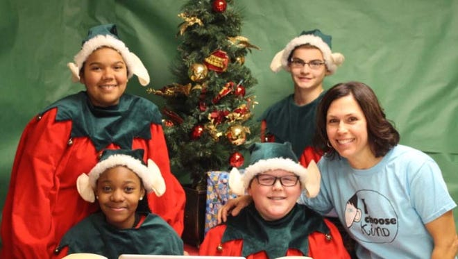 Pictured are Sabish Elves with their teacher, front row from left: Shekinah Craine, Isaac Mand, and Gina Rieder, teacher; back row: Iana Stoinski and Austin Ebben.