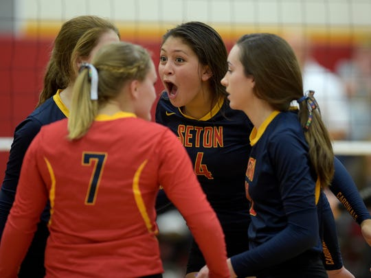 Seton Catholic and Daleville volleyball players compete in the volleyball regional Tuesday, Oct. 25, 2016 at Seton Catholic High School in Richmond.
