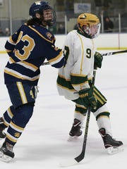 Everest's Ben Peloquin, right, had the game-winning