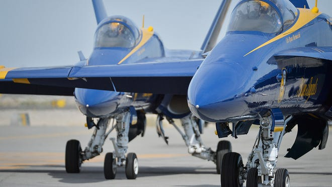 The F/A-18 Hornet the Blue Angels fly can reach speeds of about 1,400 mph, almost twice the speed of sound, and climb at a maximum rate of 30,000 feet per minute.