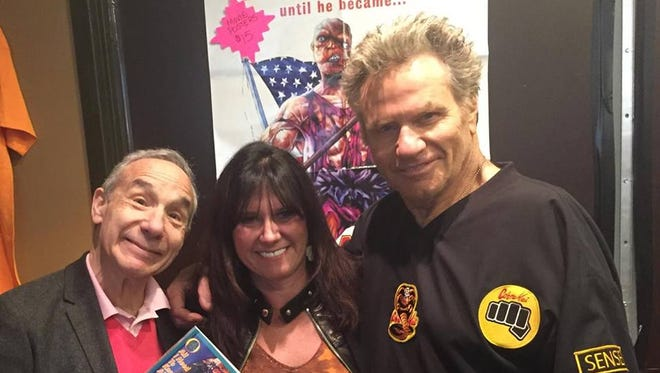 """Susan Russ of Westwood poses with the cult-film director Lloyd Kaufman, left, Martin Kove, who played the Cobra Kai sensei John Kreese in """"The Karate Kid,"""" at a previous Chiller Theatre expo."""