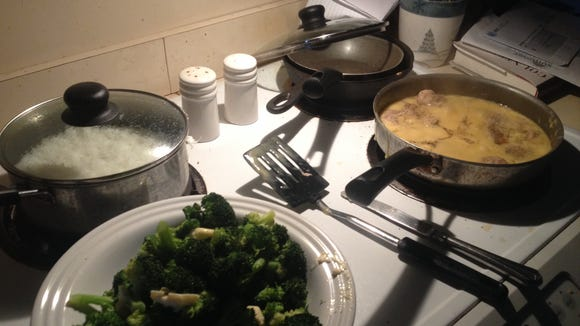 The Oeth family's dinner of rice, steamed broccoli and pork chops with gravy.