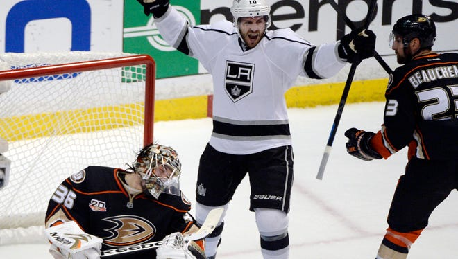 Los Angeles Kings center Mike Richards (10) celebrates after scoring a goal past Anaheim Ducks goalie John Gibson (36) during the first period of Game 7.