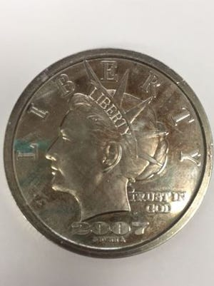 "A front look at the ""Liberty"" coin."