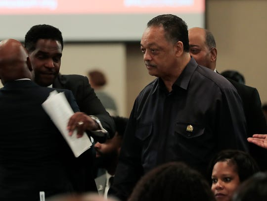 Rev. Jesse Jackson arrives at a luncheon featuring