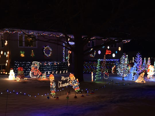 Bill and Barb Koffman  begin stringing lights at 513 St. John St., Luxemburg, right after Halloween and concluded a month later. They are winners of the Griswold category.