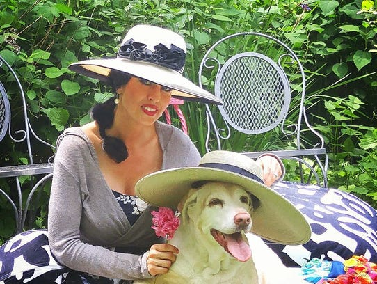 Sharla Ahmed and Tequilla at a garden party.
