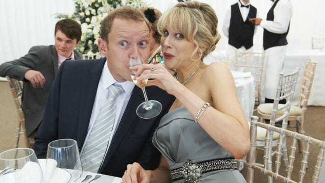 "Lucy Punch and Robert Webb in a scene from ""The Wedding Video."""