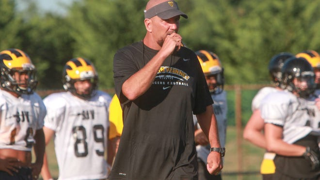 Derek Sininsky said faith has helped him get through the transition period he has gone through since being named St. John Vianney's head coach in late July