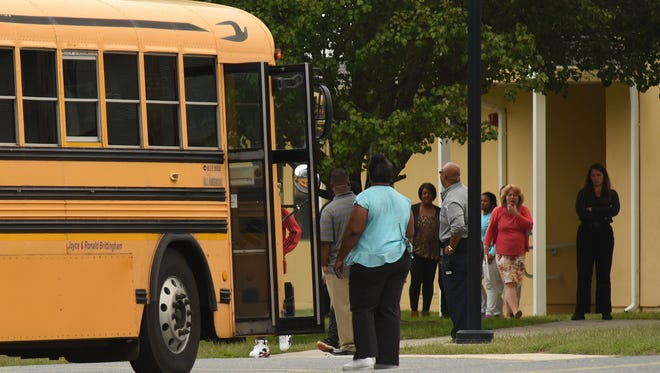 Students leave George Washington Carver Academy in Frankford at the end of school on Tuesday, Oct. 4, 2016.