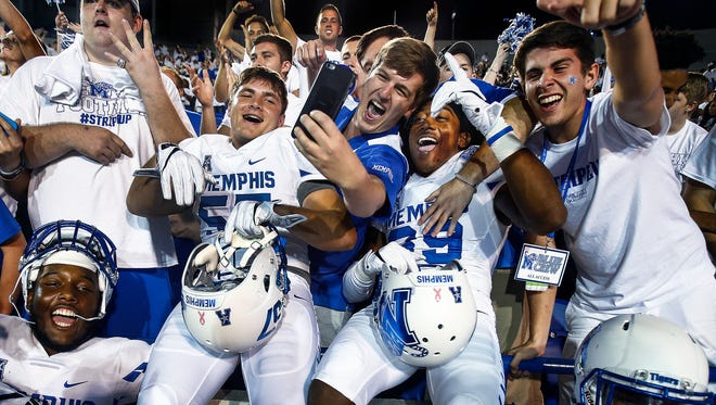 University of Memphis football players celebrate after a win over Temple in 2016.