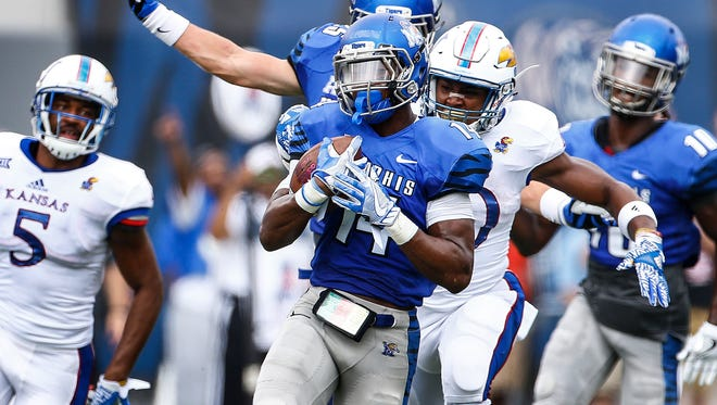 University of Memphis defender Jonathan Cook (middle) led the team with 88 total tackles