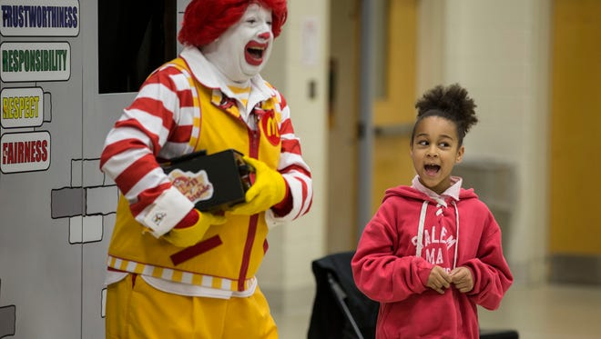 Ronald McDonald jokes around with third grader Liana Whyte, 8, during the assembly. Ronald McDonald House's foundation gives  a presentation to Neptune's Gables Elementary School for collecting 1 million soda can tabs as part of a fundraiser for the charity.Neptune City, NJThursday, January 5, 2017.@dhoodhood