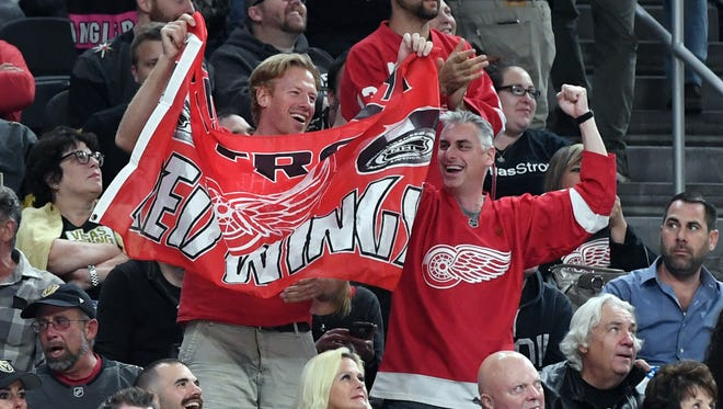Red Wings fans celebrate after Gustav Nyquist scored a first-period goal against the Golden Knights on Friday, Oct. 13, 2017, in Las Vegas.