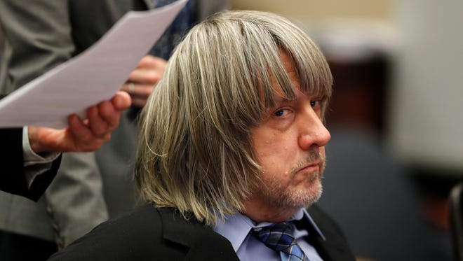 FILE - In this Jan. 24, 2018 file photo, David Turpin appears in court in Riverside, Calif. David and Louise Turpin, who are charged with torturing their children by starving, beating and shackling them, are scheduled to appear Friday, Feb. 23, 2018, in a Riverside courtroom for a conference about their case. (Mike Blake/Pool Photo via AP, File)
