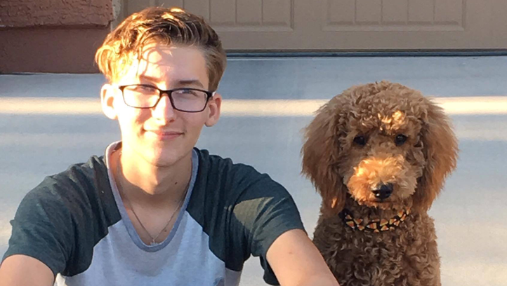 Joey Hudy, pictured in October 2016 with his mother Julie's dog, Molly.