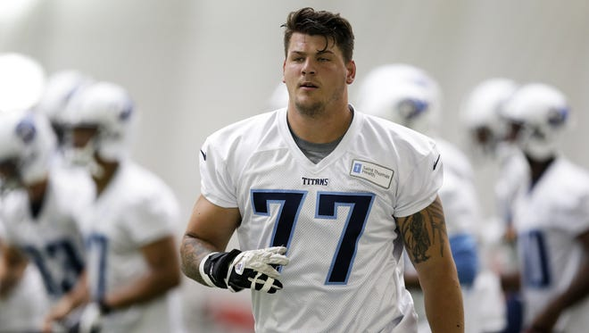 Tennessee Titans offensive tackle Taylor Lewan warms up during minicamp June 9, 2014, in Nashville, Tenn.