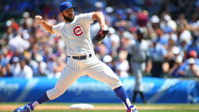 Chicago Cubs starting pitcher Jake Arrieta throws a pitch during the first inning against the Chicago White Sox at Wrigley Field.