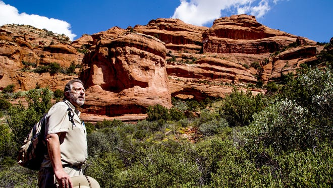 Spence Gustav, a volunteer for Sedona Friends of the Forest, talks about the propsal to make more than 250,000 acres in the Sedona area into a national monument. Gustav led a hike up the Fay Canyon Trail in Sedona, Tuesday, September 15, 2015.