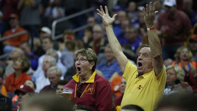 Iowa State fans react to a foul being called on the Cyclones during the Iowa State vs. Oklahoma Big 12 Tournament game on Thursday, March 10, 2016, at the Sprint Center in Kansas City. The Cyclones fell to the Sooners 79-76.