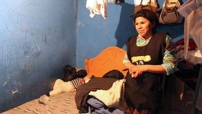 Mar'a Theresa Flores, 32œ, lives in one room with her mother and two children in a 10-person apartment in Santiago, Chile.