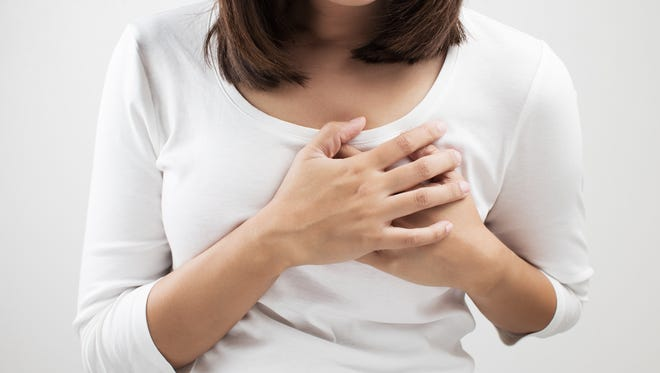 Woman having pain in the heart area.
