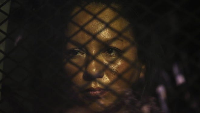 Guadalupe Garcia de Rayos is locked in a van that is stopped by protesters outside the ICE office on Feb. 8, 2017 in Phoenix. For the past four years, federal immigration authorities have given Guadalupe Garcia de Rayos a pass to remain in the U.S. rather than deport her back to Mexico.