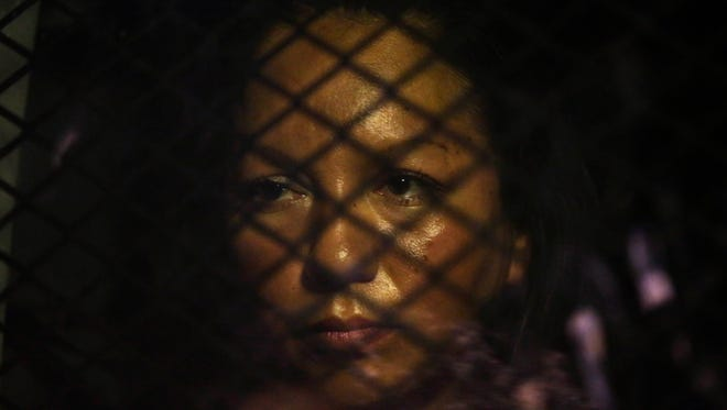 Guadalupe Garcia de Rayos is locked in a van that is stopped bu protesters outside the ICE office on Feb. 8, 2017 in Phoenix, Ariz. For the pastfouryears, federal immigration authorities have givenGuadalupe Garcia de Rayos a pass to remain in the U.S. rather than deport her back to Mexico. (Photo by Rob Schumacher/The Arizona Republic)