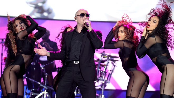 Pitbull performs to a sold-out crowd at the American Bank Center on Feb. 5, 2015.