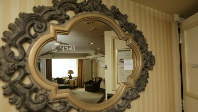 In a May 12, 2017 photo, a mirror on the wall of a The Taj Mahal room reflects the room it is in, ahead of The Taj Mahal liquidation sale on July 6, 2017. National Content Liquidators says the sale will continue until everything's gone.