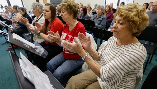 Betty Rosenberg, right, claps during rehearsal with the Intergenerational Rock Band at Drury University. Next to her is Beverly Burchett and student Raeanna Duncan.