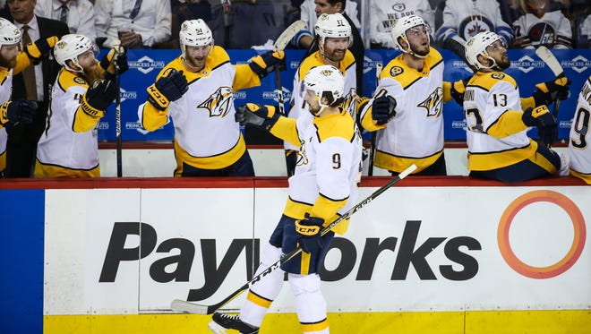 Predators left wing Filip Forsberg (9) celebrates after scoring a goal in the third period Monday.
