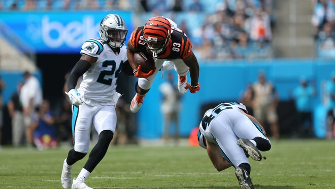 Cincinnati Bengals wide receiver Tyler Boyd (83) is upended after completing a catch in the first quarter during a Week 3 NFL game between the Cincinnati Bengals and the Carolina Panthers, Sunday, Sept. 23, 2018, at Bank of America Stadium in Charlotte, North Carolina.